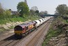 66095 passes through the cutting to the West of Ferriby at 11:53 on Friday 24th April 2015 with the 11:32 Hull Dairycoates - Rylstone empty Tarmac hoppers.
