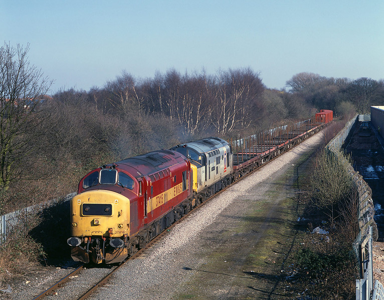 37415 and 37410 pass Southcoates lane shortly after departing Hull King George Dock with the 6D54 Enterprise Service to Doncaster, at 14:10 on March 14th 2003. The brown coloured containers at the rear of the train had been constructed locally for the MOD, and became a regular feature of the service for a few weeks.