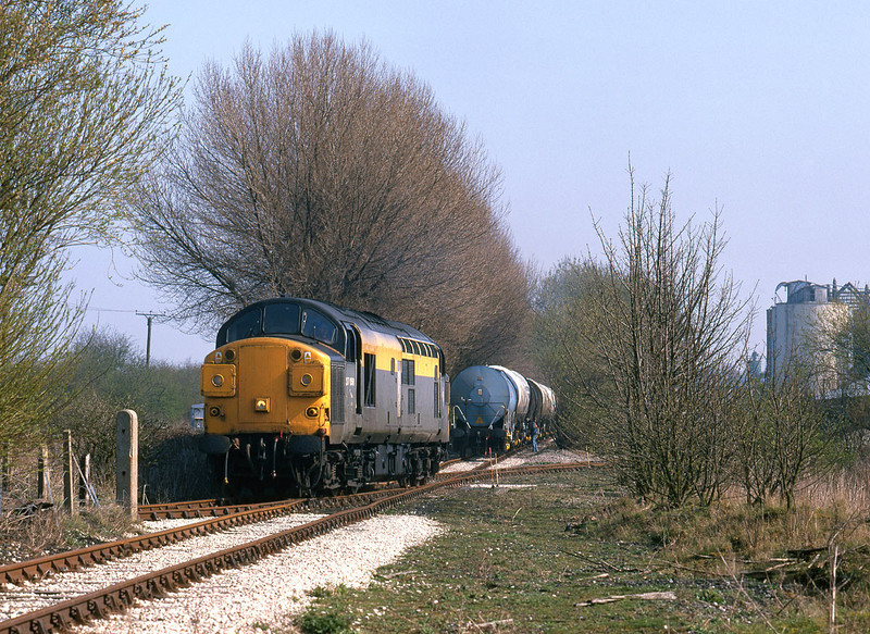 37058 stands in the works at Croxton & Garry, Melton after setting down calcium carbonate slurry tanks at 14:20 on Thursday April 1st 1999.