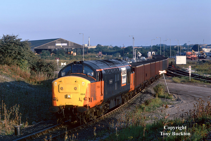 The wonders of digital imagery - this scan is from a severely under exposed slide that would otherwise never have been displayed!<br /> 37884 arrives at Hull Coal Terminal with the 6Z83 empty MEAs from Rugby at 07:00 on Wednesday 19th August 1998. An arrival at this time in the morning was unusual for these workings, normally being an hour or two later.