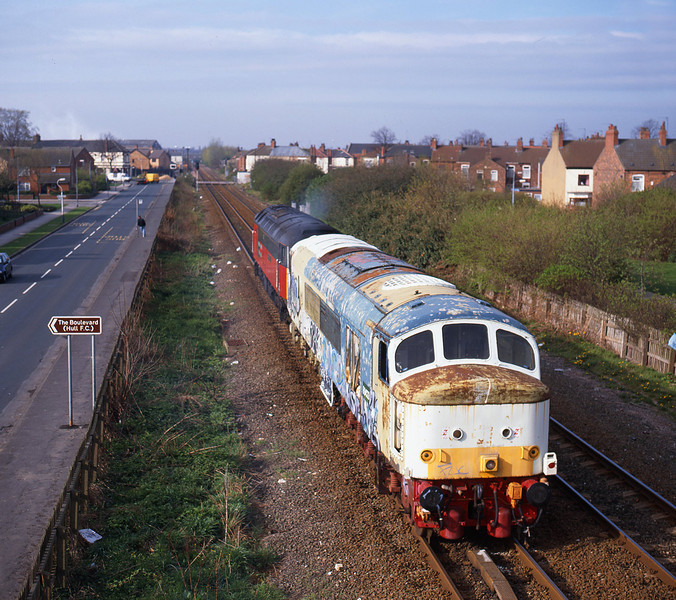 In a rather shabby state, D123 (45125) passes Selby Street, Hull, at 09:40 on the morning of March 31st 1998 in the consist of 0Z45 09:30 Hull Paragon - Loughborough. After languishing for a number of years at Hull Dairycoates, and then Botanic Gardens, a previous attempt to move the locomotive to the Great Central Railway were thwarted by the discovery of sand contamination of the brake equipment.<br /> Thankfully D123 is now restored to full working order.