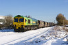 Celeb 'Shanks' liveried 66522 passes lowfield Lane Melton in deep snow on Thursday 9th December 2010, at 13:29 with a Hull C.T. - Rugeley.
