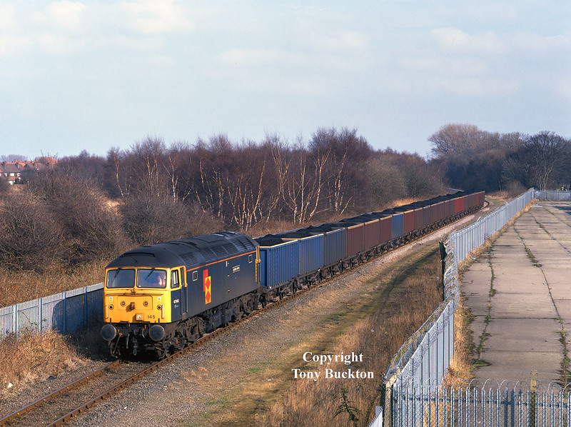 47145 is about to pass from ABP property at Southcoates Lane, Hull, at the head of 6Z93 Hull Coal Terminal - Rugby, at 14:16 on Thursday 11th March 1999.