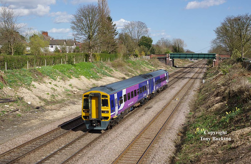 158872 passes through Ferriby Cutting on Sat 11th April 2015, forming the 1J29 13:28 Scarborough - Sheffield.