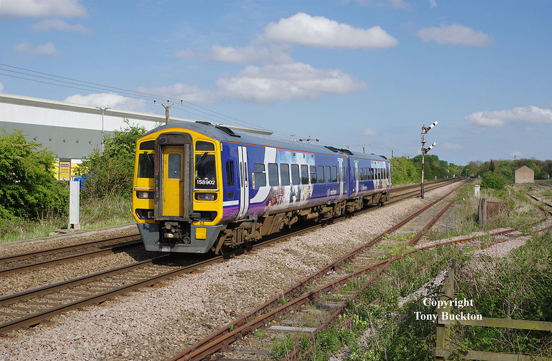 158902 passes Lowfield Lane forming the 2R10 16:10 Hull - York on  Wed 13thMay 2015.