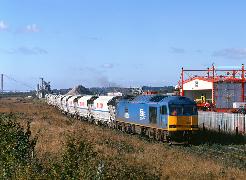 60006 'Scunthorpe Ironmaster' draws away from the unloading bunker at Hull Dairycoates on 12th October 1998, before running round to form the 6D04 11:23 empty hoppers to Rylstone.