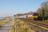 66151 heads the late running 07:00 Drax P.S. - Hull Biomass LP along Hessle Foreshore at 11:37 on Friday 29th December 2016.