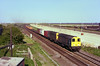 20009 & 20167 pass Hessle Haven on the evening of May 30th 1985 with the daily  4L68 18:34 Hull F.L.T. - York Dringhouses Freightliner. <br /> Directly behind the train Hull's (then) new A63 trunk road (Clive Sullivan Way) can be seen in the making, whilst in the distance the lighting towers of the Freightliner terminal can be made out.<br /> Rather inexplicably, class 20's became an occasional feature on this train for a period of around 18 months and always made my day if photted as they had otherwise disappeared from the area a few years earlier.