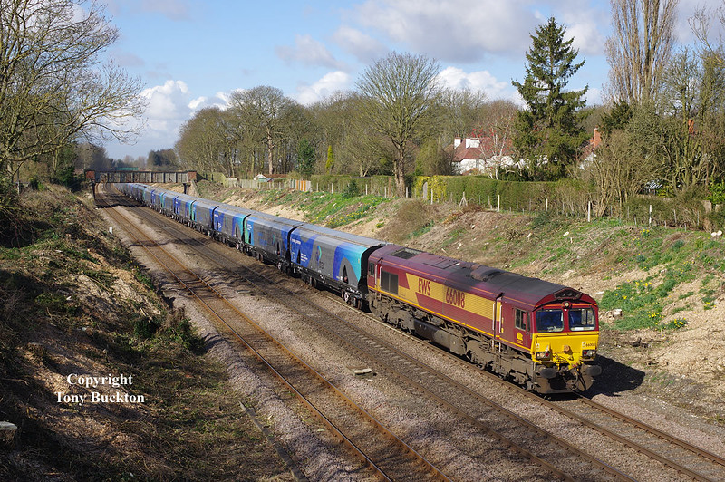 66008 passes through the cutting on the approaches to Ferriby station with the 09:23 Milford West Yard  empty Biomass hoppers to Hull at 10:03 on Tuesday 24th March 2015.<br /> Line-side vegetation has been extensively cleared in this area recently, which has opened up this shot enabling a more pleasing composition.