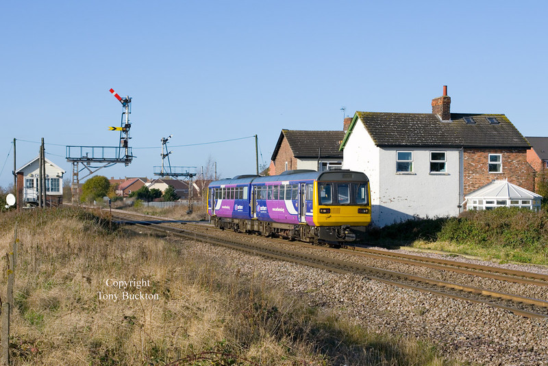 142020 passes Welton at 11:36 on Wednesday  20th November 2013 as the 2C22 10:51 Doncaster - Hull.