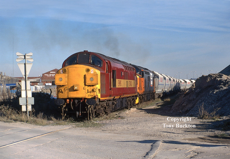 37042 and 37698 depart from hull Dairycoates with the late running 6D04 empty Tilcon hoppers to Rylstone, at 13:17 on Wed 29th October 1997.