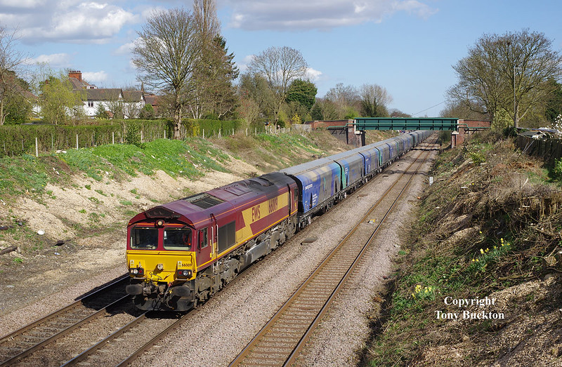 66009 passes through Ferriby Cutting in spanking Spring sunshine at 15:17 on Saturday 11th April 2015, with the 14:13 Hull Biomass LP - Drax. <br /> The timings of this Saturday working are slightly better for the lighting angle than the normal weekday departures - being approximately  40 mins earlier. The cutting has been recently cleared of vegetation, and has been a target of mine for the last few weeks with this being my first 'Sun on the front' freight shot from this vantage point - a  good visit was had with a number of unit types also being recorded.