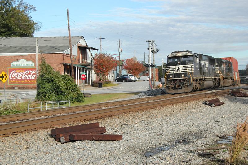 231-05 [Intermodal; Garden City, GA-Austell, GA]<br /> NB NS 6957 (SD60E)<br /> NS 8367 (C40-8W)<br /> <br /> 87 platforms international doublestacks. #2 to runaround at NS Austell,<br /> Austell, GA.<br /> <br /> the Coca-Cola sign- the signature afternoon shots in sun at Austell!