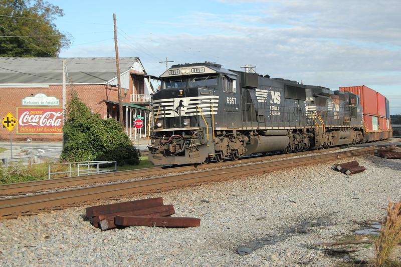 231-05 [Intermodal; Garden City, GA-Austell, GA]<br /> NB NS 6957 (SD60E)<br /> NS 8367 (C40-8W)<br /> <br /> 87 platforms international doublestacks. #2 to runaround at NS Austell,<br /> Austell, GA.<br /> <br /> * We shot 25Q downtown where workers had just put up Christmas Decorations,<br /> 23N at Sweetwater Creek and 231 in a sunlight sucker hole with the Coca-Cola sign- the signature afternoon shots in sun at Austell!