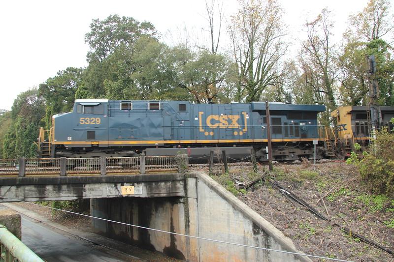 Q237-05 [Automotive; Louisville, KY-Baldwin, FL] SB  CSXT 5329 (ES44DC) CSXT 42 (AC4400CW, YN2)  78 loaded autoracks. #2 at CSX Bolton, Atlanta, GA. Got some good shots of the NC&StL bridge.