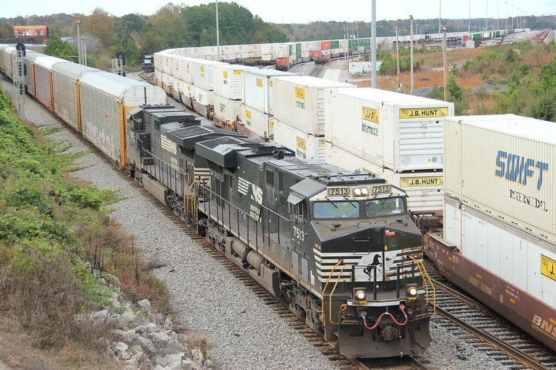 275-05 [Automotive; Shelbyville, KY-Atlanta, GA]<br /> SB NS 7513 (ES44DC)<br /> NS 9351 (C44-9W)<br /> <br /> 83 loaded autoracks. Main at NS England, Austell, GA.