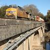 23N-06 [Intermodal; Atlanta, GA-Memphis, TN]<br /> NB UP 5532 (AC4400CTE, flag)<br /> <br /> NS 4004 (AC44C4M, Lion's Mane Primer Fish Paint)<br /> UP 6868 (AC4400CW, flag)<br /> <br /> 86 platforms intermodal (25 international intermodal, 61 domestic<br /> doublestacks). Shot crossing Sweetwater Creek. #2 to runaround at NS Austell,<br /> Austell, GA. Since 25Q originated in Atlanta today instead of Savannah, these<br /> were back to back Atlanta-Memphis intermodals!