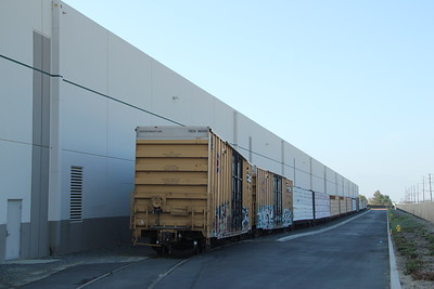 Spur along building had boxcars and centerbeam flats of lumber for Home Depot Distribution Center.  Wineville Ave and Philadelphia St.