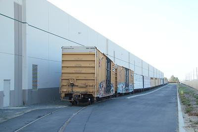 Ontario:  Spur along building had boxcars and centerbeam flats of lumber for Home Depot Distribution Center.  Wineville Ave and Philadelphia St.