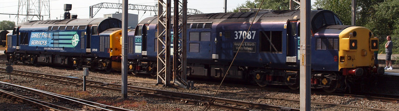 37087 and 37510 arrive at Crewe from Gresty Bridge depot round the corner, to attach to the tour stock.
