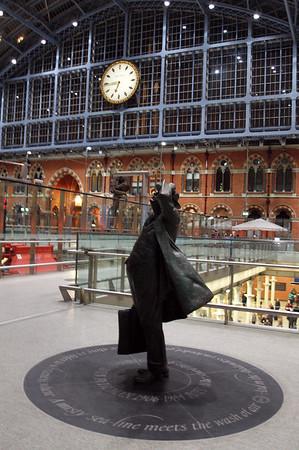 Sir John Betjeman checks the time - I hope he's not running late!