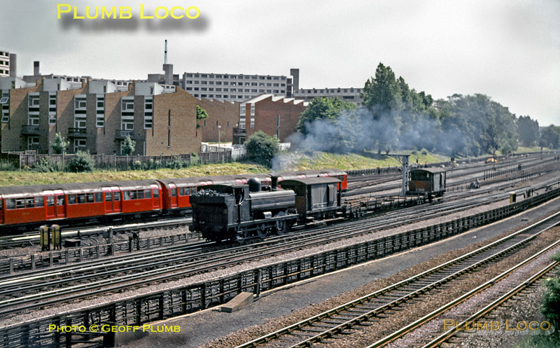 LT 0-6-0PT No. L89 (ex-BR & GWR No. 5775) works up the gradient from the underpass out of Neasden depot and is approaching Wembley Park station with the works train to Croxley tip, as a southbound Bakerloo line train of 1938 stock heads for Baker Street (no Jubilee Line then!). The tracks in the foreground are the BR lines from Marylebone. June 1969. Slide No. 3813.