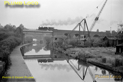 A familiar location but before the old canal wharf was regenerated into today's leisure marina, the old infrastructure gradually falling apart. An unidentified LT 0-6-0PT has run round its train and watered at Watford station and is now making its way to the tip at Croxley with the spoil train from Neasden. Date unknown, but a misty, murky sort of day, around June 1968!