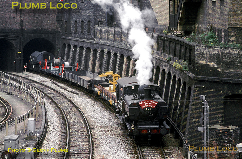 """Ex-GWR 57xx 0-6-0PT No. L94 (ex-7752) works """"The Last Steam Train on the Underground"""", a demonstration works train here seen at Farringdon being stopped by signals on the """"Widened Lines"""" from Moorgate, before getting the road again on its trip to Neasden Depot. This loco made it into preservation as 7752 at the Birmingham Railway Museum, Tyseley. Sunday 6th June 1971. Slide No. 7065."""