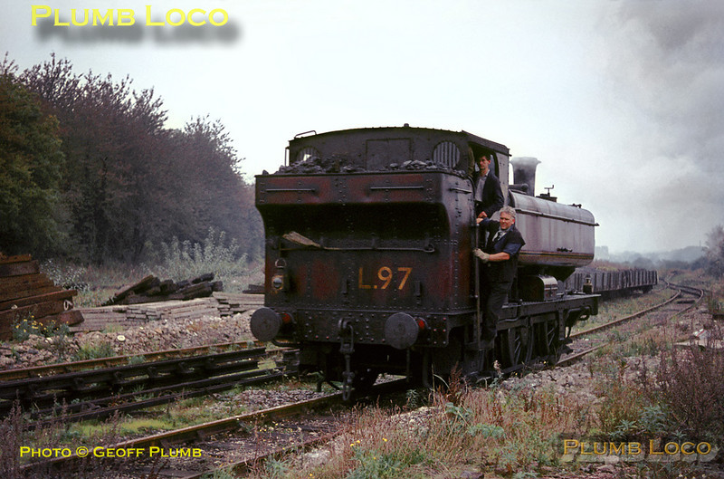 The shunter at Croxley Tip hitches a ride on the cab steps of LT 0-6-0PT No. L97 as it runs round some wagons at the tip during shunting on Monday 31st October 1966. Slide No. 2578.