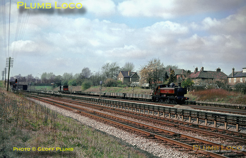 LT 0-6-0PT No. L93 approaching Northwick Park station with the return empty wagons of the spoil train from Croxley Tip to Neasden Depot, running on the up fast Metropolitan Line track. The tracks in the foreground are the former Great Central Railway route into London Marylebone station. April 1967. Slide No. 2725.