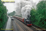 """Ex-Great Northern Railway 0-6-2T, LNER Class N2/2, BR No. 69523 is blasting away from the station stop at Rickmansworth during a """"Steam on the Met"""" season of Amersham to Watford shuttles, this being the 11:14 from Watford. The loco is one of the class fitted with condensing gear to work over the """"Widened Lines"""" of the Metropolitan Railway, so no stranger to LT metals. It is hauling a set of former SR 4TC stock painted into Metropolitan livery and Bo-Bo diesel No. 20227 brings up the rear to provide air-braking for the train. Various sets of A60 Met Line stock are stabled in the sidings alongside, these trains now also being part of history after a very long life. 11:45, Saturday 21st May 1994, a very wet day! Slide No. 23856."""
