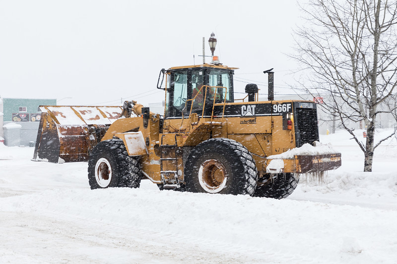 Caterpillar loader 966F clearing snow at Cochrane station.