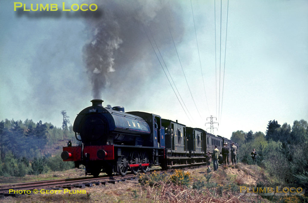 "LMR WD ""Austerity"" 0-6-0ST No. AD196 performs a spirited ""run-past"" whilst traversing the Hollywater Loop line with a train of brakevans and ancient former SE&CR coaches in tow, presumably, no worries about fire-risk! Saturday 30th April 1966. Slide No. 1980. Since writing this caption I have heard from Mike Christensen OBE that in fact No. 196 did start quite a lot of fires during this run and the second run around the loop had to be diesel-hauled! Mike is the co-author of a new two-part book on the LMR, the first part of which has just been published by Lightmoor Press."
