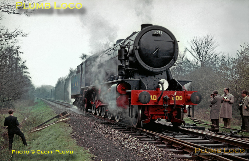 "Watched by tour participants and supervised by Army personnel, 2-10-0 AD600 ""Gordon"" runs round the train at Liss LMR station, before coupling up to AD195 and then double-heading the train to Longmoor Downs. Saturday 16th April 1966. Slide No. 1944."