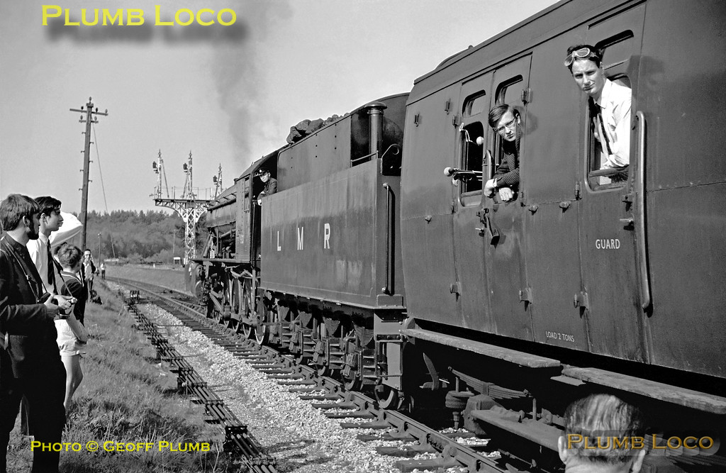 """After arriving into the LMR station at Bordon with 0-6-0ST No. AD196 leading and WD 2-10-0 No. AD600 """"Gordon"""" on the rear, the train was then shunted over into the SR station by 600 before departing along the branch to Bentley and on to Staines, where """"Gordon"""" came off the train. The SR branch can be seen curving off to the left while the LMR line curves away to the right beyond the rather fine three doll bracket signal, now minus its arms after the closure of the branch. Saturday 30th April 1966."""