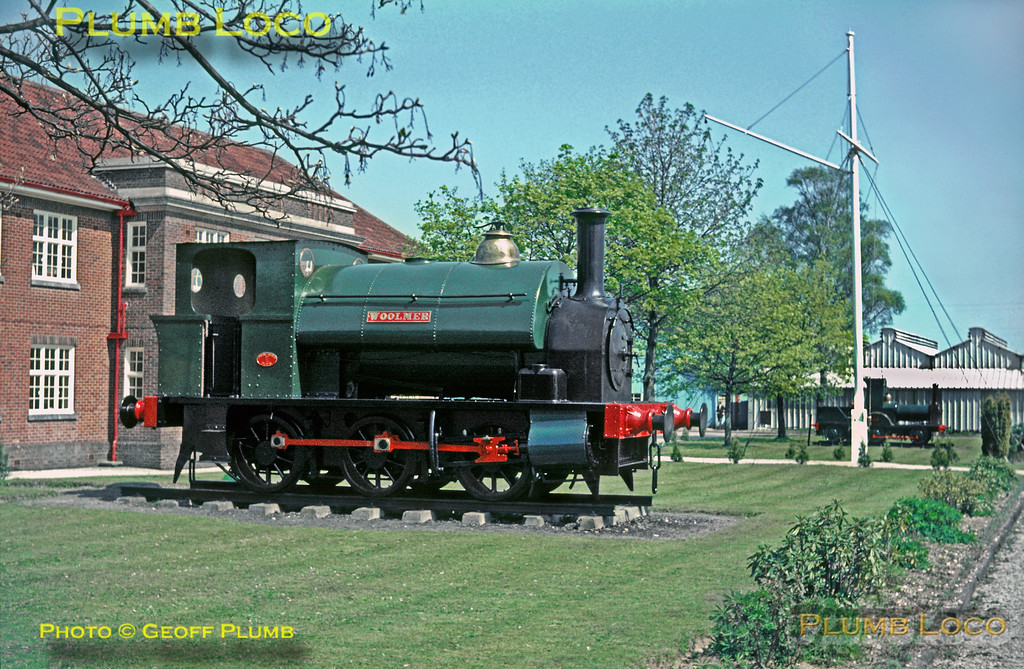 """Outside the HQ building at Longmoor camp were two plinthed locos, the nearer one is 0-6-0ST """"Woolmer"""" (Avonside 1572/1910), while the further one is the diminutive 0-4-2WT """"Gazelle"""" (Dodman & Co., King's Lynn, 1893). Saturday 30th April 1966. Slide No. 1982."""