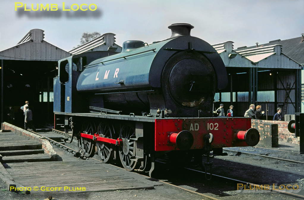 Austerity 0-6-0ST No. AD102 is standing outside the running shed at Longmoor during the visit of the RCTS railtour. Saturday 30th April 1966. Slide No. 1984.