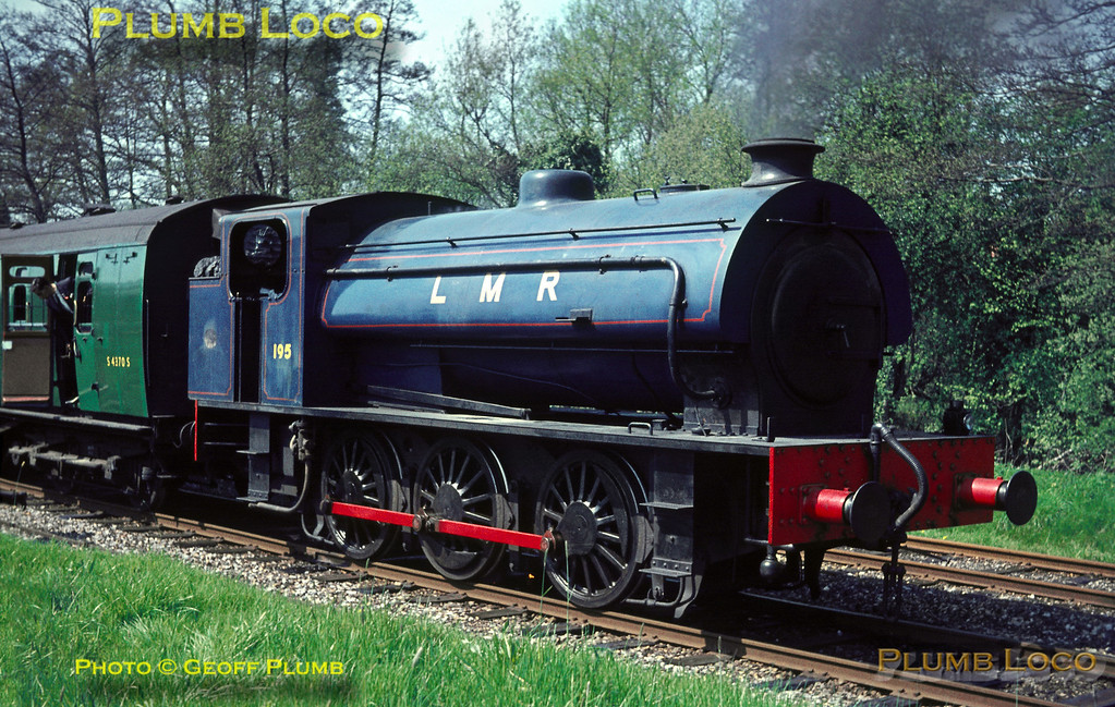 """""""Austerity"""" 0-6-0ST No. AD (Army Department) 195 has backed onto the stock of the RCTS """"Longmoor Military Railtour"""" at Liss LMR station. The train had been brought to this point by WD 2-10-0 No. AD600 """"Gordon"""" from Woking. Saturday 30th April 1966. Slide No. 1973."""