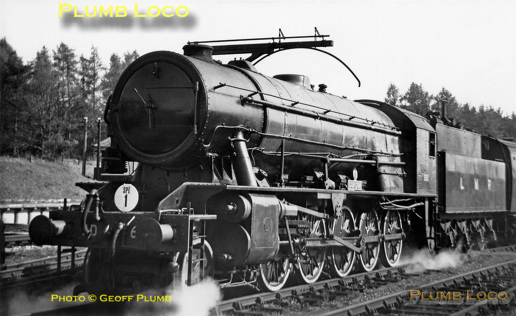 """LMR WD 2-10-0 No. AD600 """"Gordon"""" stands at the head of the RCTS """"Longmoor Military Railtour"""" under the loading gauge in the SR yard of Bordon station (the LMR platform can be seen in the left background), before setting off for Staines. Saturday 30th April 1966."""