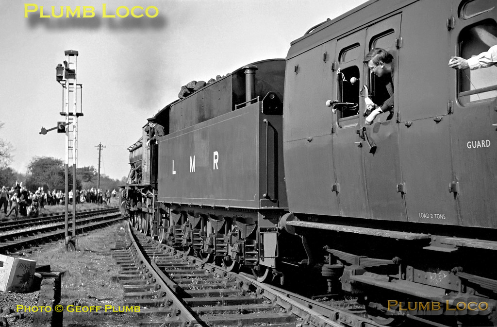 """Longmoor Military Railway WD 2-10-0 No. AD 600 """"Gordon"""" manoeuvres the stock of the RCTS """"Longmoor Miltary Railtour"""" out of the LMR platforms before reversing into the BR platforms at Bordon, end of the branch line from Bentley. This was during the second of the tour's two runs, on Saturday 30th April 1966. The line from Bentley to Bordon closed to passengers in September 1957 and by this time the freight services had ceased as well from 4th April 1966. The track was lifted later the same year. There are now moves afoot to reopen it!"""