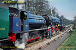 """Watched by tour participants and supervised by Army personnel, 2-10-0 AD600 """"Gordon"""" has run round the train at Liss LMR station, before coupling up to AD195 and then double-heading the train to Longmoor Downs. Saturday 30th April 1966. Slide No. 1975."""