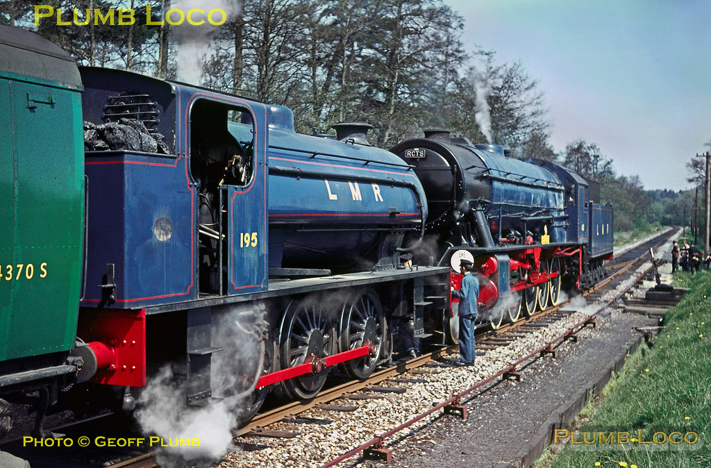 "Watched by tour participants and supervised by Army personnel, 2-10-0 AD600 ""Gordon"" has run round the train at Liss LMR station, before coupling up to AD195 and then double-heading the train to Longmoor Downs. Saturday 30th April 1966. Slide No. 1975."