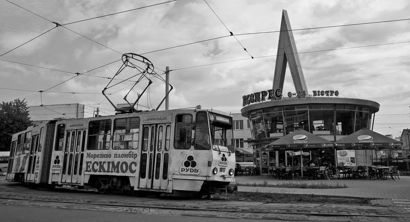 The caff sits in the centre of the turning circle outside the station. A Number One tram moves forward to pick up passengers heading into the city.