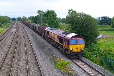 With the white cab roof of 66177 trying to brighten up the dull evening as it passes Magor with 6B50 15.00 Swindon to Llanwern steel empties. Tuesday 31st July 2012.