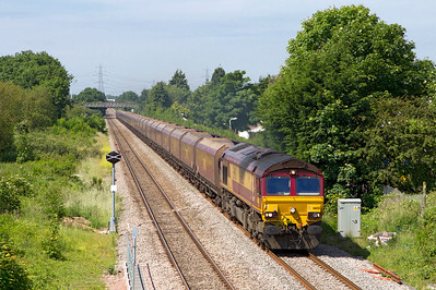 66135 passes the site of Portskewett station with 4E66 08.55 Margam to Redcar empty coke hoppers. Wednesday 20th June 2012.