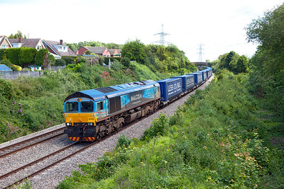 Malcolm liveried 66434 heads the 4V38 08.22 Daventry to Wentloog Tesco train past Portskewett. Wednesday 20th June 2012.