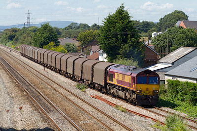 66095 heads along the 'up' slow at Magor with 6O32 Margam to Dollands Moor loaded steel for export. Friday 27th July 2012.