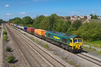 66537 passes Church Road, Undy with 4O51 09.58 Wentloog to Southampton Freightliner. Friday 27th July 2012.