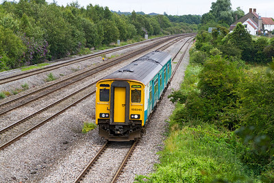 150245 passes Church Road, Undy on the slow forming the 14.33 Gloucester to Fishguard Harbour. Tuesday 31st July 2012.