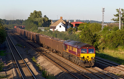 With the evening shadows lengthening 66141 passes Undy with 6V06 15.10 Handsworth to Cardiff Tidal Yard loaded scrap train. Tuesday 24th July 2012.